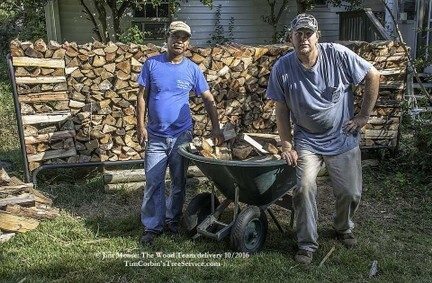 Employees deliver & stack firewood: timcorbinstreeservice.com
